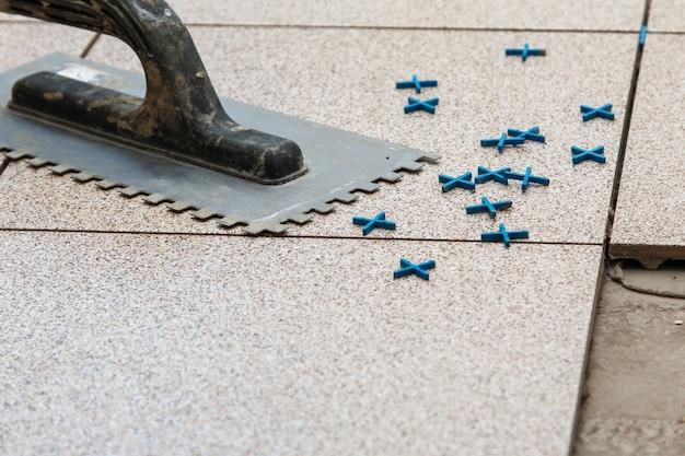 Installation of floor tiles