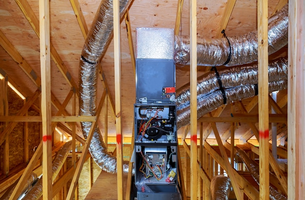 Installation of heating system on the roof of the pipe system of heating closeup
