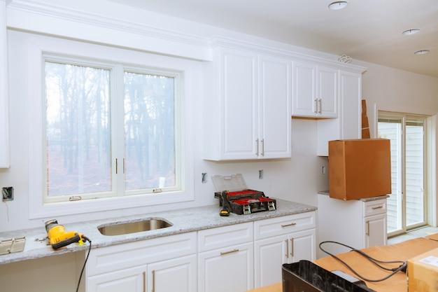 Premium Photo Installation Of Kitchen Installs Kitchen Cabinet Interior Design Construction Kitchen