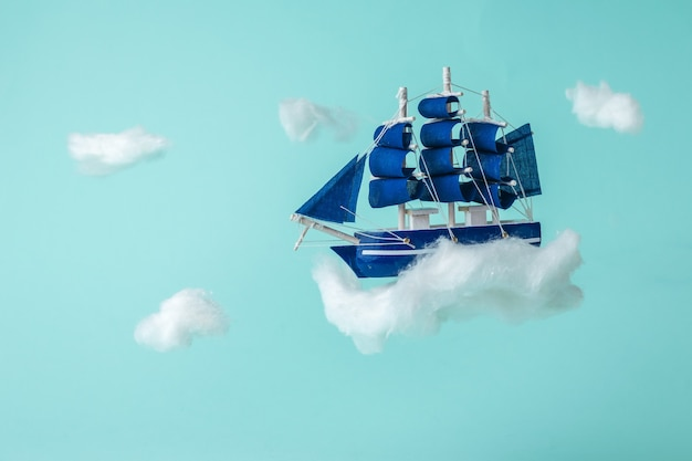 Installation of a sailboat flying through the sky between the clouds. a dream come true.
