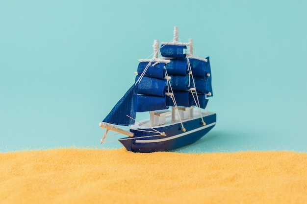 Installation of a sailboat mooring to a sandy beach. the concept of travel and adventure. installation.