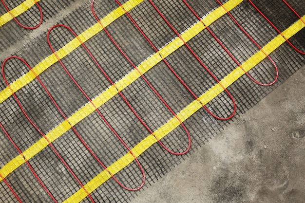 Installation of underfloor heating for thermal comfort close up