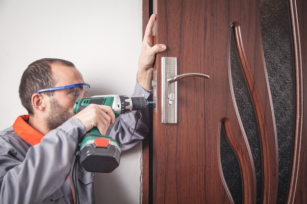 Installation with a lock in the door using a drill screwdriver.