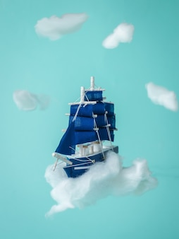 Installation with a sailboat flying in the clouds. a dream come true.