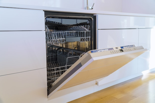Installed new appliances dishwasher in kitchen with modern domestic kitchen cabinets