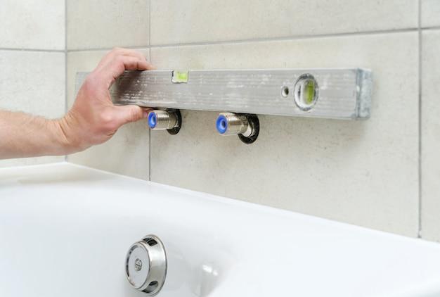 Installing bath faucet.