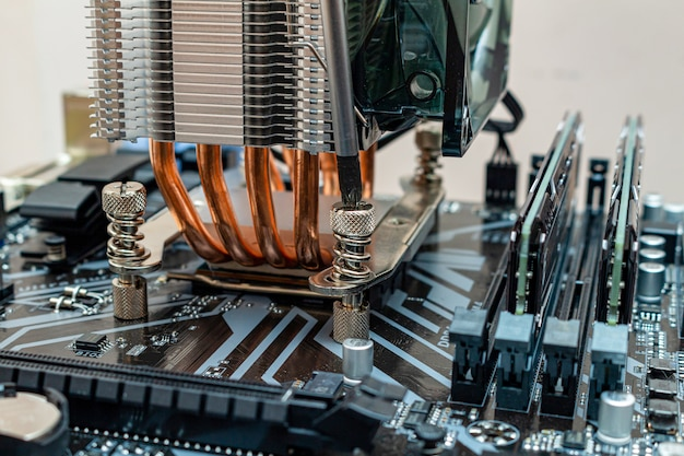 Installing a cooler on a personal computer. the process of upgrading computer maintenance in a service.