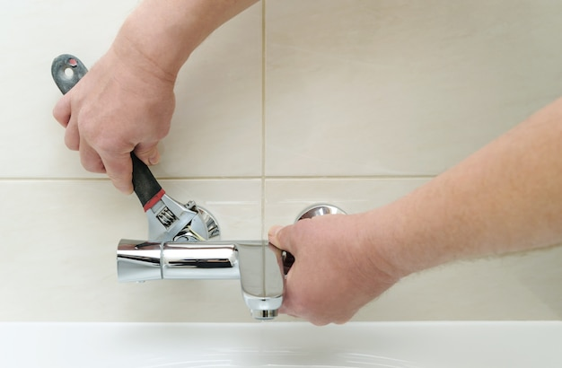 Installing faucet with thermostat.