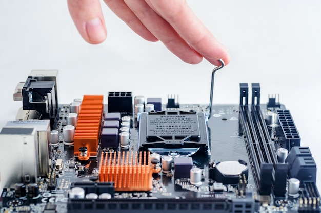 Installing the processor in the computer's motherboard.
