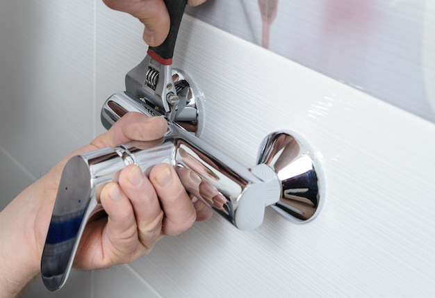 Installing a shower faucet.