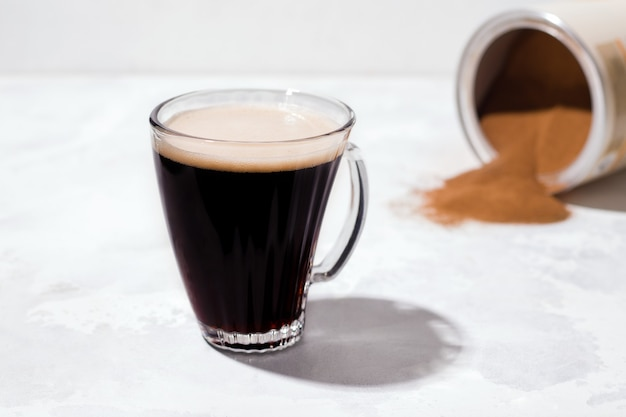 Instant black barley coffee on a light background