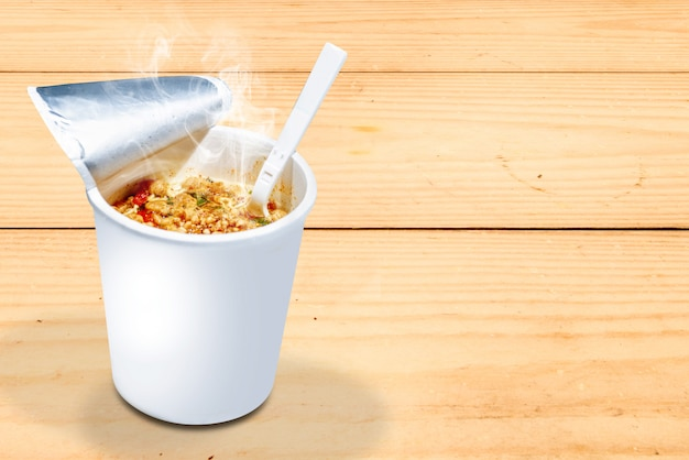 Instant cup noodle with fork
