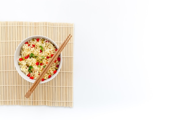 Instant noodle with pepper peas chopstick and greens