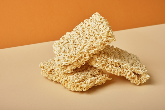 Instant noodles on beige and brown table.copy space