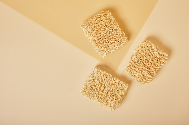 Instant noodles on beige table. top view top view