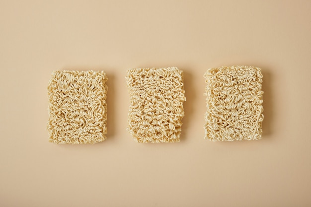 Instant noodles on beige table. top view