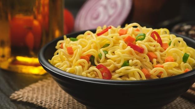 Instant noodles on black background
