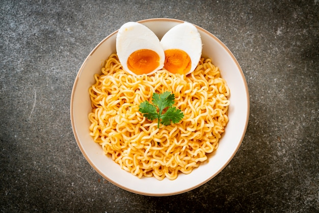 Instant noodles bowl with salt egg