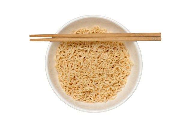 Instant noodles in ceramic bowl with chopsticks. instant noodles in ceramic bowl with chopsticks top view isolated on white background.