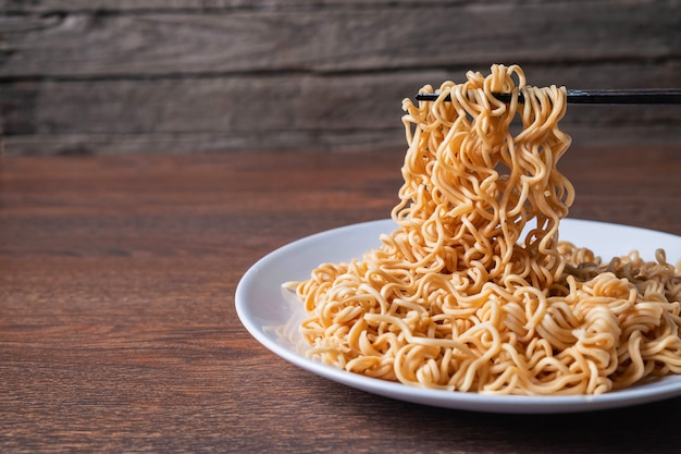 Instant noodles on plate on the table
