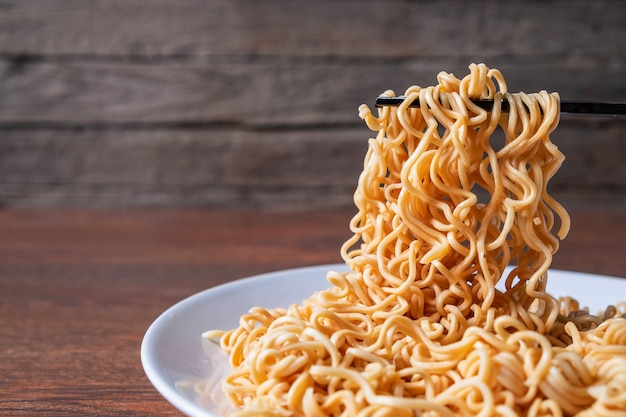 Instant noodles on a plate on the table