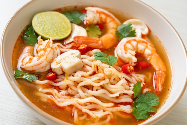 Instant noodles ramen in spicy soup with shrimps (tom yum kung) - asian food style
