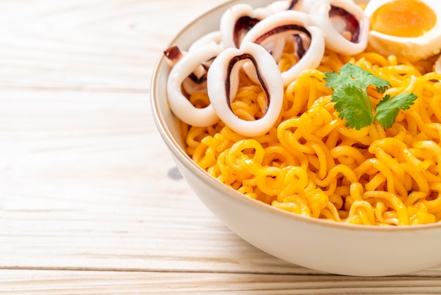 Instant noodles salt egg flavour with squid or octopus bowl