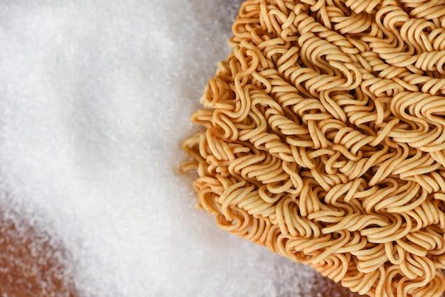 Instant noodles on seasonings on table