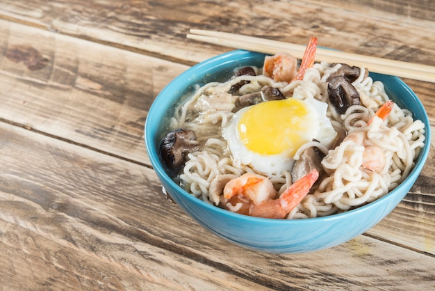 Instant noodles soup with shrimps, egg and mushrooms.