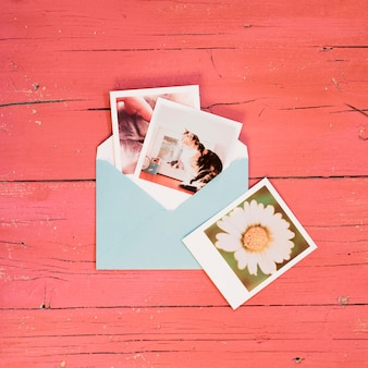 Instant photos on a blue envelope