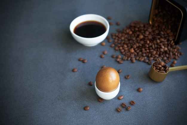 Instructions how to color easter eggs with natural dye. brown color from coffee. copy space. grey background