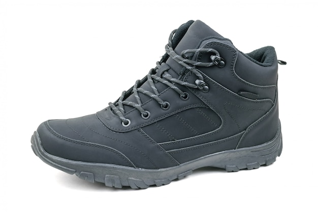 Insulated black men's shoes on the left leg isolated on a white background.