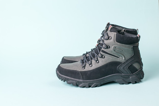 Insulated men's stylish walking shoes for travel on blue.