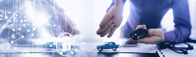 The insurance agent signs a document. car insurance policy. auto insurance policy. forms for registration of the contract.