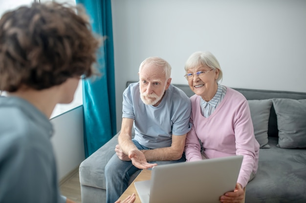 Insurance contract. senior couple having an appointment with health insurance agent and discussing the contract details