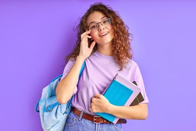 Intelligent caucasian student girl in eyeglasses enjoying education