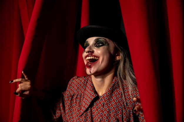 Intense shot of a halloween make-up woman laughing