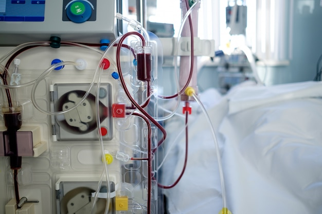 Intensive care emergency room with hemodialysis machine (or hemofiltration procedure), patient in critical stance
