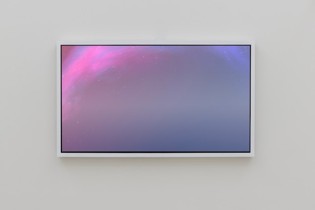 Interactive pink screen on wall in gallery