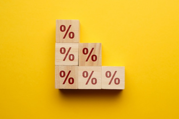 Interest rate growth concept loans icons on wooden blocks.