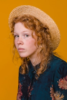 Interested redheaded woman in studio