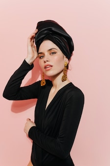Interested young lady touching turban