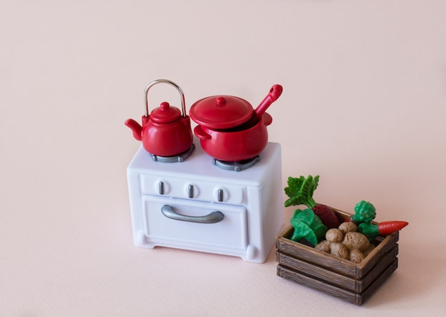 Interioir of the kitchen: stove, dishes and box of vegetables