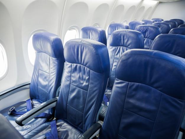 Interior of airplane passenger seats.