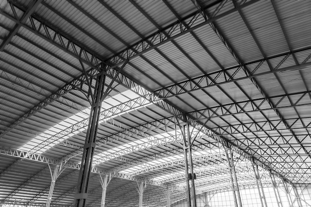 Interior architecture design of warehouse large metal roof structures of steel ceiling.