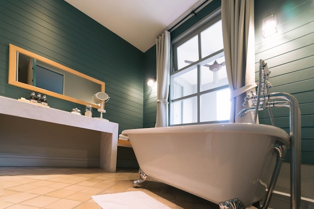 Interior of bathroom with white bath tub