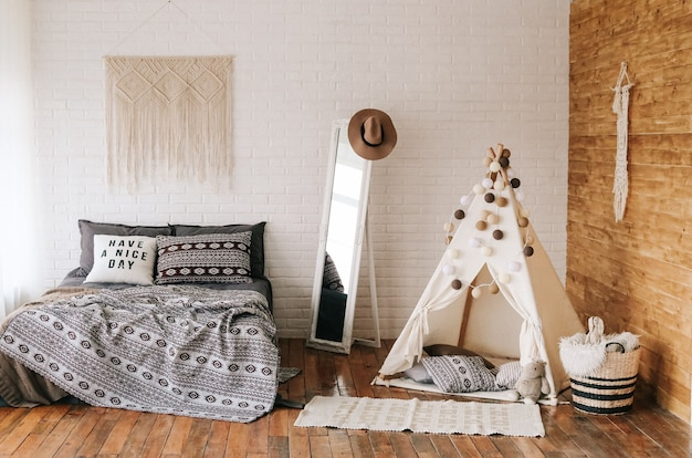 Interior of bedroom bed boho style