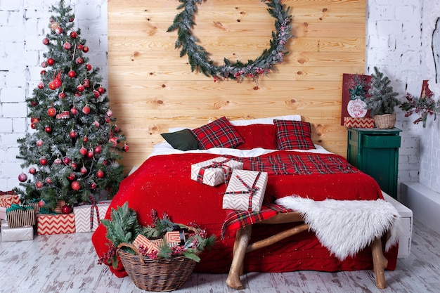 Interior bedroom is decorated for christmas.