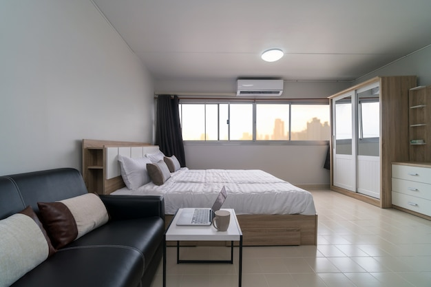 Interior bedroom with leather sofa of living room and dining table