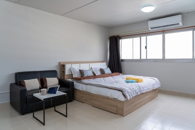 Interior bedroom with leather sofa of living room, studio room type of condominium